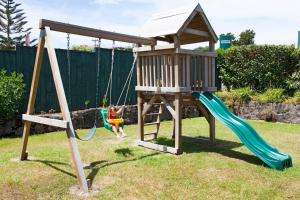 Children's play area at Accommodation at Te Puna Motel and Holiday Park
