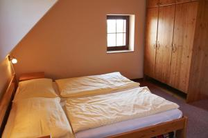 A bed or beds in a room at Schneeberg Apartmany