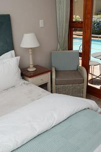 A bed or beds in a room at Oleander Guest House