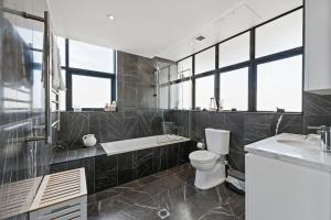 A bathroom at Darling Harbour Penthouse Views+Jacuzzi