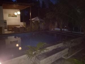 The swimming pool at or near Swara Homestay 2