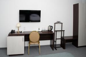 A television and/or entertainment center at Chaika Gostinichny Kompleks