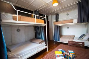 A bunk bed or bunk beds in a room at 1918's HOSTEL