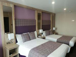 A bed or beds in a room at Mount Errigal Hotel, Conference & Leisure Centre
