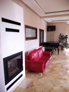 Telewizja i/lub zestaw kina domowego w obiekcie Hotel Litwiński