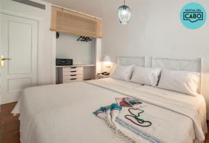 Cama o camas de una habitación en Hostal del Cabo
