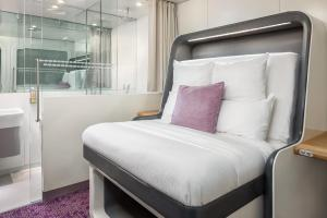 A bed or beds in a room at YOTELAIR London Gatwick Airport