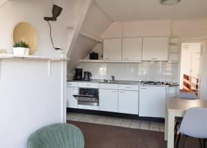 A kitchen or kitchenette at Apartment De Zeemeermin
