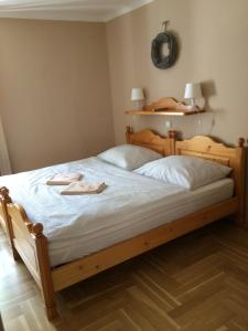 A bed or beds in a room at Pension U Mrázků