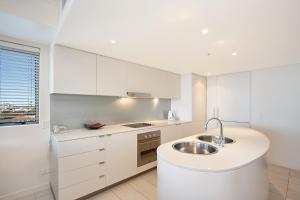 A kitchen or kitchenette at Blue C Coolangatta