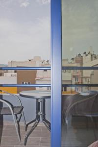 A balcony or terrace at Danaos Hotel