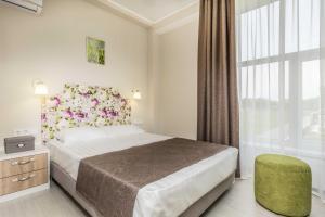 Кровать или кровати в номере Апартаменты в Вилле Ла Мелиа