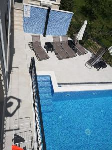 A view of the pool at Villa Mambo or nearby