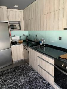 A kitchen or kitchenette at Douro Real Apartments