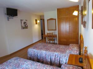 Cama o camas de una habitación en Hotel Las Nieves