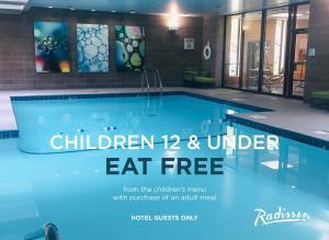 The swimming pool at or near Radisson Hotel Corning