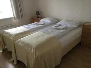 Ein Bett oder Betten in einem Zimmer der Unterkunft Guesthouse Stekkatún