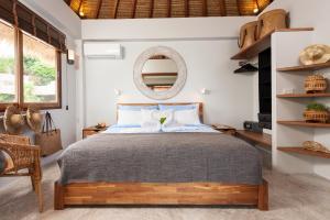 Ein Bett oder Betten in einem Zimmer der Unterkunft Cape Shark Villas