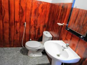 A bathroom at Cresent Bay Beach Hotel