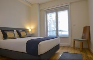 A bed or beds in a room at Spot Apartments Ceuta