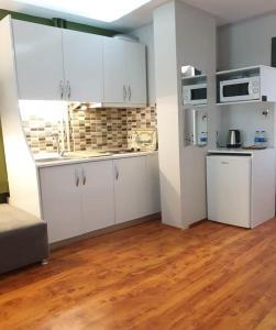 Кухня или мини-кухня в Away Hotel