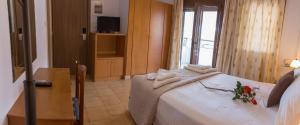Ένα ή περισσότερα κρεβάτια σε δωμάτιο στο studio nufaro