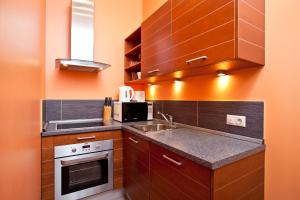 A kitchen or kitchenette at Moscow Suites Apartments Tverskaya
