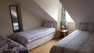 A bed or beds in a room at Homely and enjoyable Holiday home