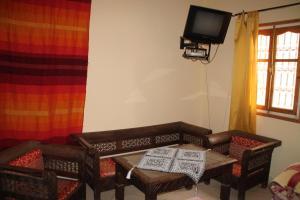 تلفاز و/أو أجهزة ترفيهية في Ecolodge Espace Tamount