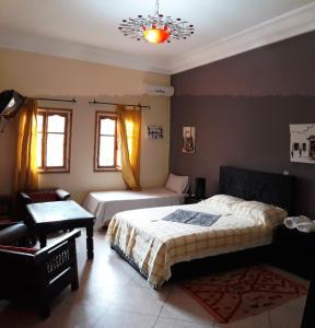 سرير أو أسرّة في غرفة في Ecolodge Espace Tamount