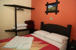 A bed or beds in a room at Hotel Fazenda Alamo