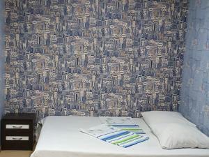 Кровать или кровати в номере В гостях у моря