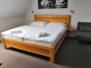Postel nebo postele na pokoji v ubytování Penzion Laskala Tišnov