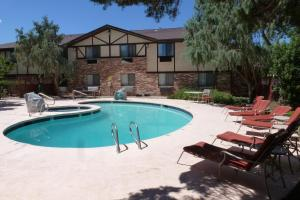 The swimming pool at or near Super 8 by Wyndham Moab