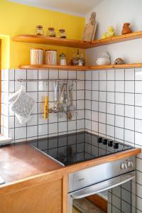 Kuchyň nebo kuchyňský kout v ubytování Apartman Skroza