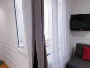 Een TV en/of entertainmentcenter bij Apartment Quartier Latin - Monge