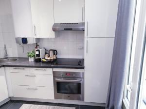 Een keuken of kitchenette bij Apartment Quartier Latin - Monge