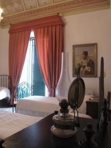 A bed or beds in a room at B&B di Charme Camelie