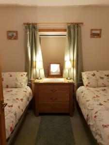 A bed or beds in a room at Tiffyhall