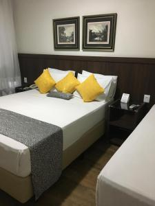 A bed or beds in a room at Hotel Conceição