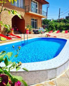 The swimming pool at or near Tatiko`s Villa