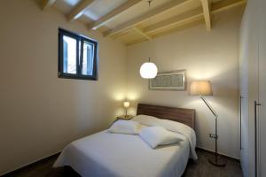 Säng eller sängar i ett rum på Villa Kalypso
