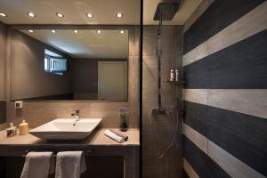 Ett badrum på Villa Kalypso
