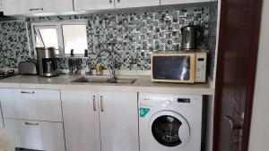 A kitchen or kitchenette at Easy World Beach Apartments