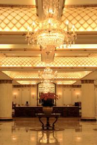 The lobby or reception area at Le Midi Hotel Chitou