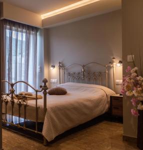 Ένα ή περισσότερα κρεβάτια σε δωμάτιο στο Maltezos Rooms