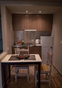 Η κουζίνα ή μικρή κουζίνα στο Maltezos Rooms