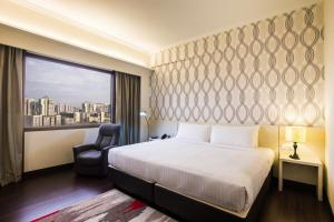 A bed or beds in a room at Village Hotel Bugis by Far East Hospitality (SG Clean)