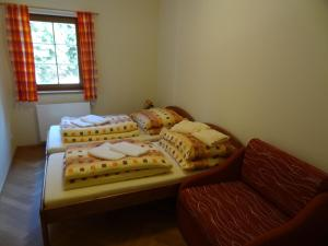 A bed or beds in a room at Apartmány Pod Javorem