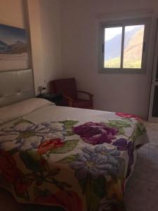 Cama o camas de una habitación en Viviendas Vacacionales Vista Mar y Monte